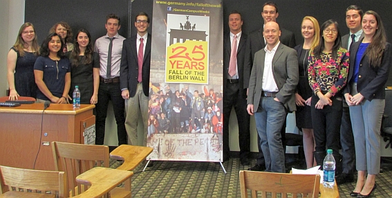 German Department students with a banner celebrating the 25th anniverary of the fall of the Berlin Wall