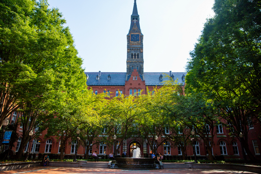 Healy Hall clock and courtyard with trees